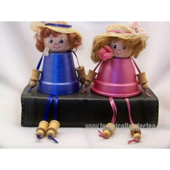 Cute sitting girls made of clay flower pots